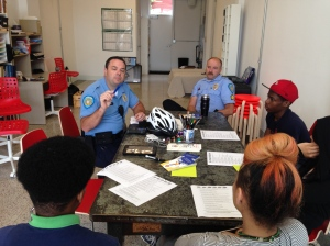 Teens participate in a Bike Safety Workshop with Washington University Police at the Stitchers Storefront Studio, 616 N Skinker Blvd.
