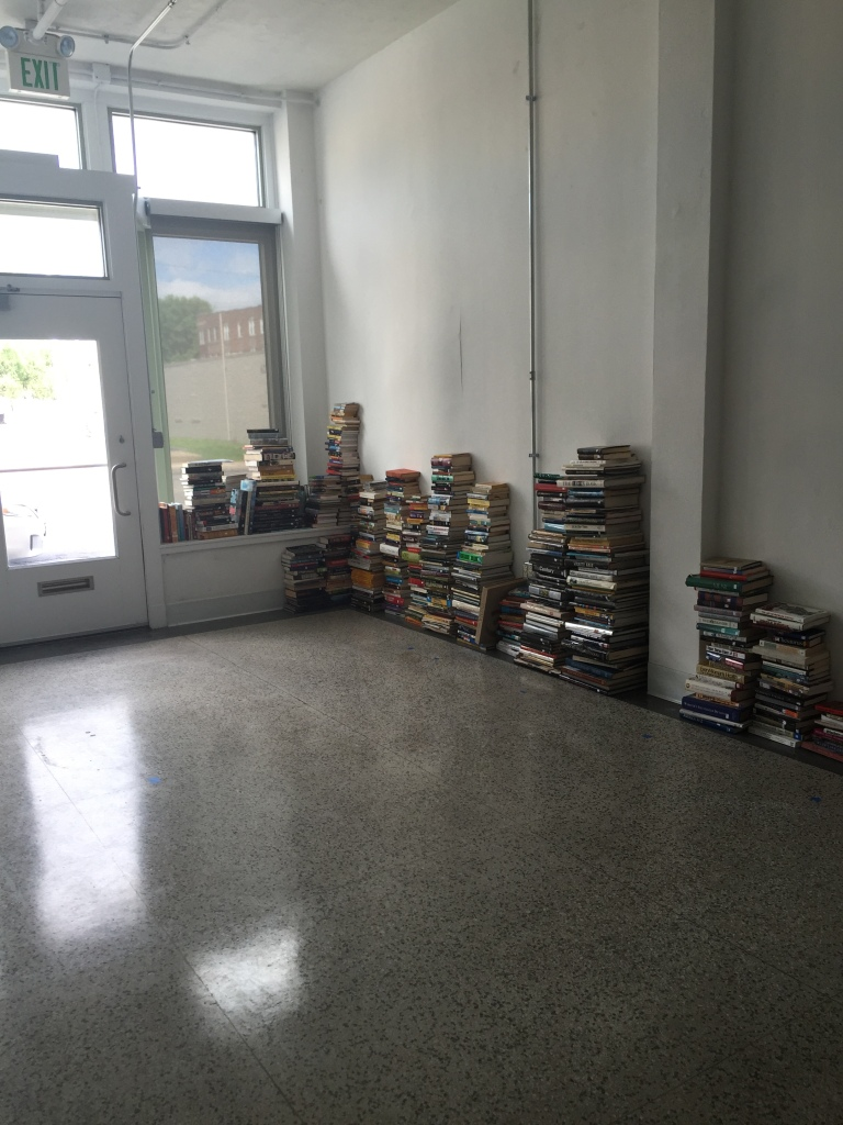 Books donated by West County Book Fair await in the Stitchers Storefront Studio, 616 N Skinker Blvd. Photo by Buzz Spector